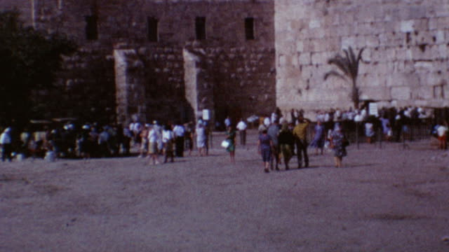 kotel prayer on dirt ground prior to marble flooring western wall plaza at old city on august 10 1967 in jerusalem israel - sechstagekrieg stock-videos und b-roll-filmmaterial
