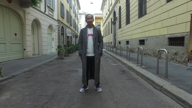 Kou Mitsuhashi is wearing a Supreme pullover Haider Ackermann coat Adidas shoes Loewe backpack and Tonello pants on January 15 2017 in Milan Italy