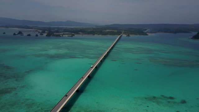 kouri bridge and seascape of nago, okinawa, japan - mountain range stock videos & royalty-free footage