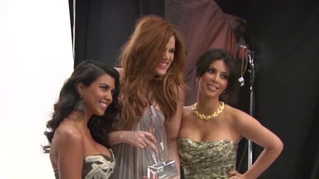 Kourtney Kardashian Khloe Kardashian and Kim Kardashian at the People's Choice Awards Photo Booth at Los Angeles CA
