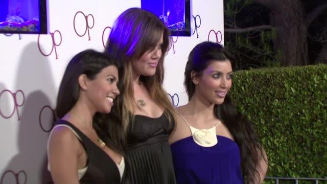 Kourtney Kardashian Kim Kardashian Khloe Kardashian at the Op Advertising Campaign Launch at Los Angeles CA