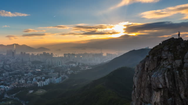 kowloon skyline and lion rock at dusk - hill stock videos & royalty-free footage