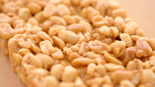 kozinaki of peanut, close up - peanut food stock videos & royalty-free footage