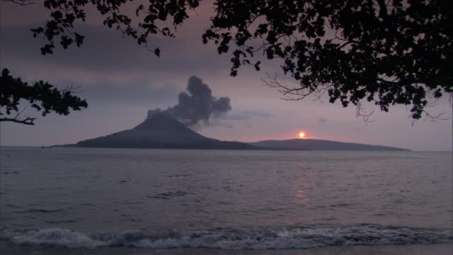 krakatoa emits smoke as it erupts. - erupting stock videos & royalty-free footage