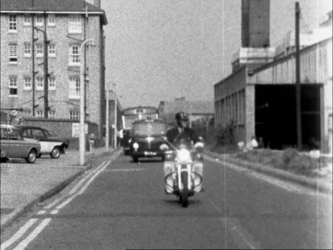 kray brothers en route to bow street england london brixton hill ms police m/cycle leading followed by police vans towards past lr to bv followed by... - police car stock videos and b-roll footage