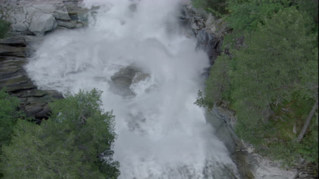 krimmel falls crash into a river in the swiss alps. available in hd. - waterfall stock-videos und b-roll-filmmaterial