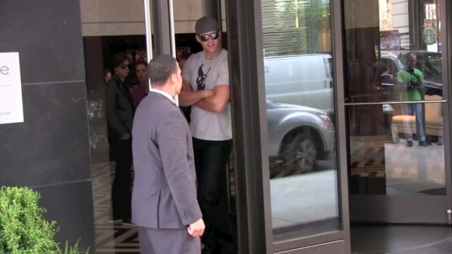 Kris Humphries watches the paparazzi from the door of the Gansevoort Hotel in New York