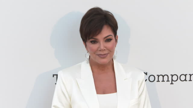 Kris Jenner and Corey Gamble at the amfAR Cannes Gala 2019 Arrivals at Hotel du CapEdenRoc on May 23 2019 in Cap d'Antibes France