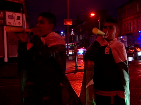 general views of glasgow its asian community and edinburgh high court scotland glasgow general views of young asian men celebrating eid on streets/... - pakistani flag stock videos & royalty-free footage