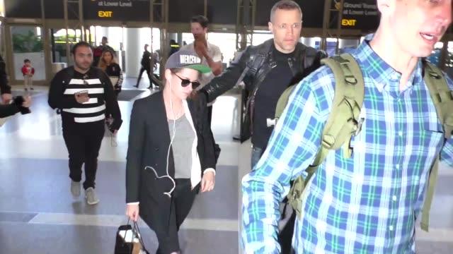 kristen stewart departing at lax airport in los angeles in celebrity sightings in los angeles - kristen stewart stock videos and b-roll footage