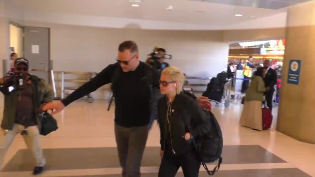 kristen stewart departing at lax airport - kristen stewart stock videos and b-roll footage