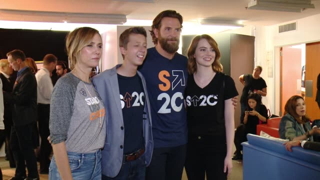 Kristen Wiig Bradley Cooper and Emma Stone at Stand Up To Cancer 2016 at Walt Disney Concert Hall on September 09 2016 in Los Angeles California