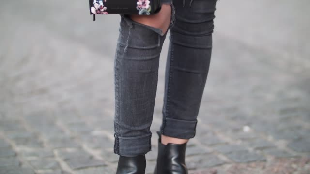 Kristi Gogsadze fashion blogger La Georgienne wears Zara black denim jeans cropped and ripped trousers a Zara black top a Zara green bomber jacket...