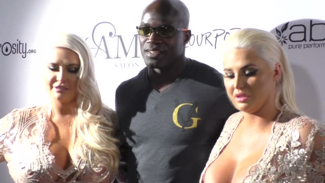 kristina shannon, karissa shannon & cheick kongo at the glam beverly hills salon grand opening and ribbon cutting celebration in beverly hills on... - beverly hills点の映像素材/bロール