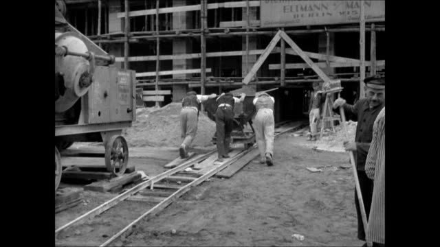 krupp's munitions factory in essen men workers pushing ore cart on rail male drilling hillside three males operating portable mixer possibly tar ws... - ruhr stock videos & royalty-free footage