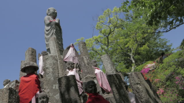 """ksitigarbha (""""""""jizo"""""""" in japanese) stone statue in japan - place concerning death stock videos and b-roll footage"""