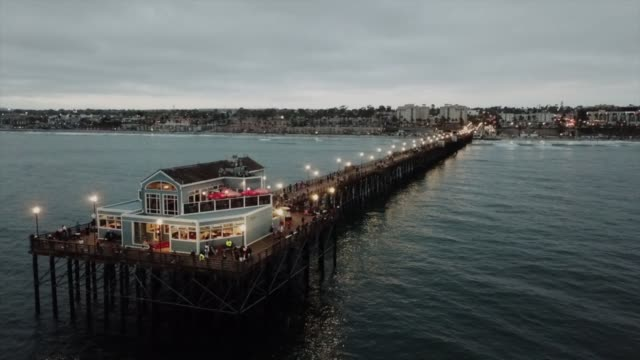 drone pov oceanside pier - oceanside stock videos and b-roll footage
