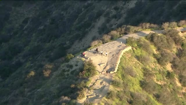 aerials of runyon canyon park in los angeles - canyon stock videos & royalty-free footage