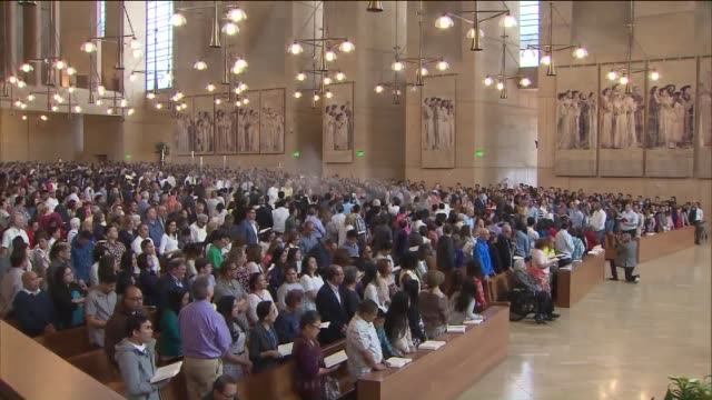 easter mass at the cathedral of our lady of the angels - religious service stock videos & royalty-free footage