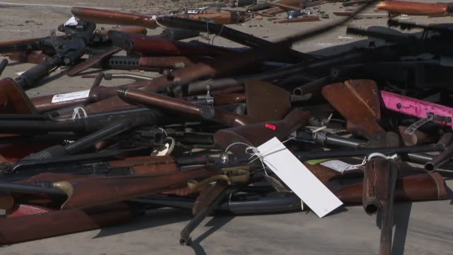 stockvideo's en b-roll-footage met more than 3,500 guns, many of which obtained during criminal investigations and probation seizures, are being melted down in rancho cucamonga. - probatie