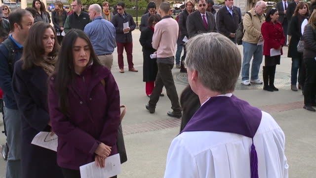 Catholic Priest Distributes Ashes on Ash Wednesday