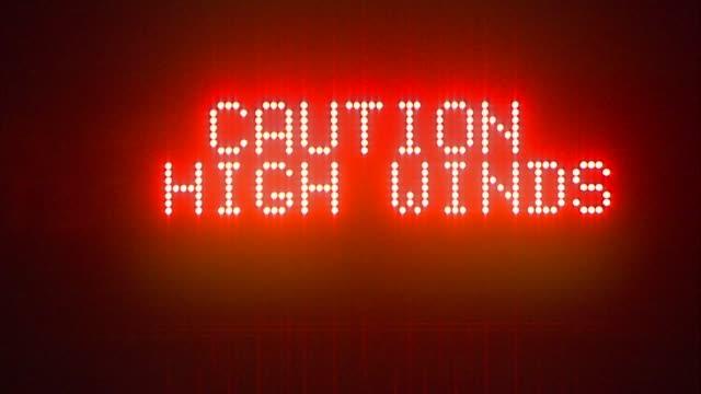 freeway sign warns of high winds. - digital skyltning bildbanksvideor och videomaterial från bakom kulisserna