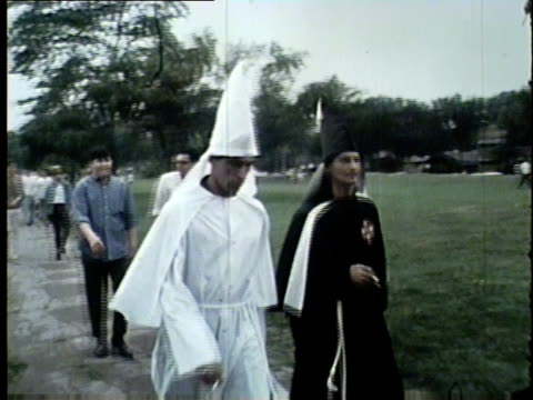 wgn ku klux klan members gather near demonstration lead by martin luther king jr king and other civil rights leaders led several marches and... - confederate flag stock videos & royalty-free footage