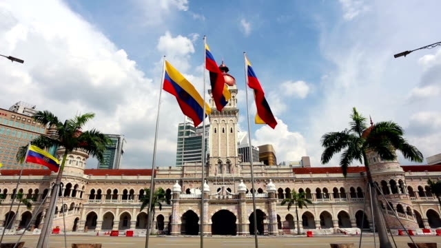 kuala lumpur city flags in front of the ultan abdul samad building in malaysia capital city. - sultan abdul samad building stock videos & royalty-free footage