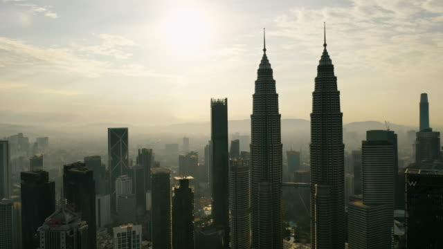 kuala lumpur city skyline on sunrise in malaysia. - petronas towers stock videos & royalty-free footage
