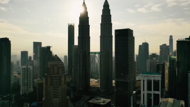 kuala lumpur city skyline on sunrise in malaysia. - sydostasien bildbanksvideor och videomaterial från bakom kulisserna