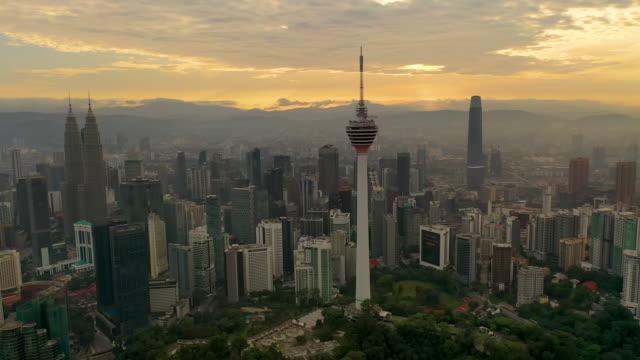 kuala lumpur city skyline on sunrise in malaysia. - menara kuala lumpur tower stock videos & royalty-free footage