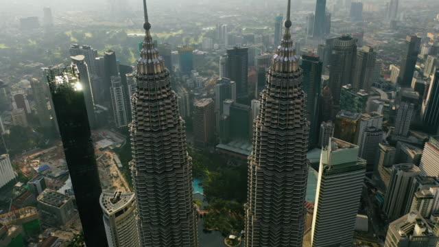 kuala lumpur city skyline on sunrise in malaysia. - petronas twin towers stock videos & royalty-free footage