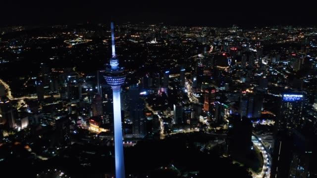 kuala lumpur downtown at night - menara kuala lumpur tower stock videos & royalty-free footage