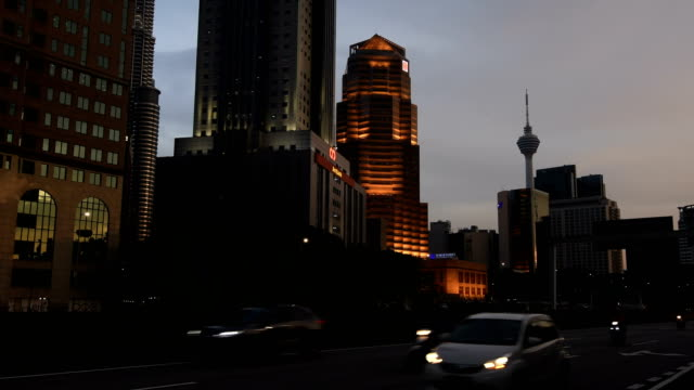 kuala lumpur skyline with kl tower - menara kuala lumpur tower stock videos & royalty-free footage