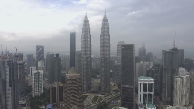 kuala lumpur skyscrapers from adove view - petronas twin towers stock videos & royalty-free footage