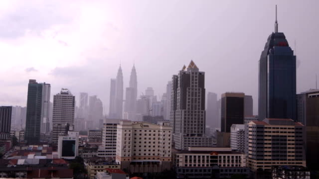 kuala lumpur time lapse daytime during a rain storm hd video - petronas twin towers stock videos & royalty-free footage