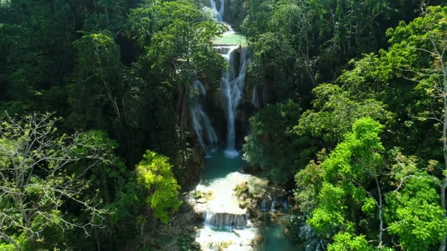 stockvideo's en b-roll-footage met kuang si waterfall famous landmark nature travel place of luang prabang city, laos. bird eye view landscape. - tropisch regenwoud