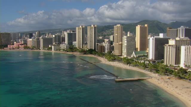 kuhio beach park and waikiki skyscrapers on the coast of honolulu, hawaii. - hawaii islands stock videos & royalty-free footage