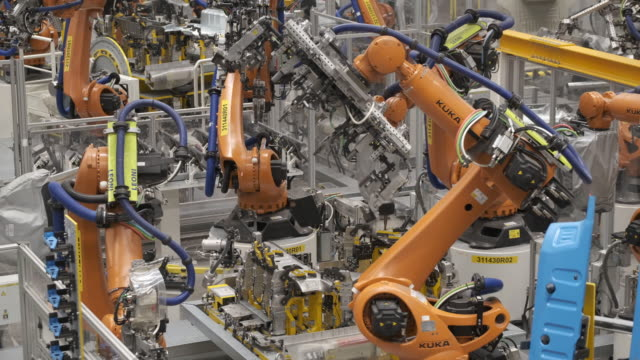kuka industrial robots weld body sections of id.3 electric cars at the volkswagen factory on february 25, 2020 in zwickau, germany. volkswagen is... - industry stock videos & royalty-free footage