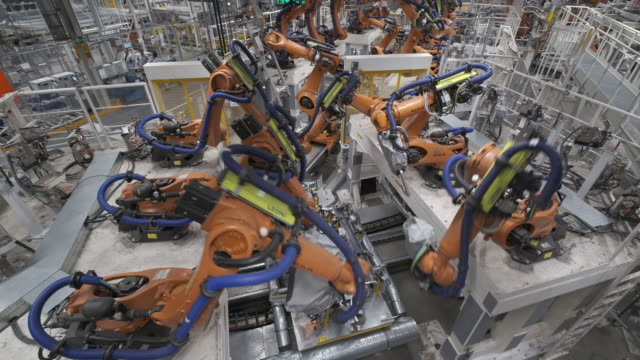 kuka industrial robots weld body sections of id3 electric cars at the volkswagen factory on february 25 2020 in zwickau germany volkswagen is... - automobile industry stock-videos und b-roll-filmmaterial