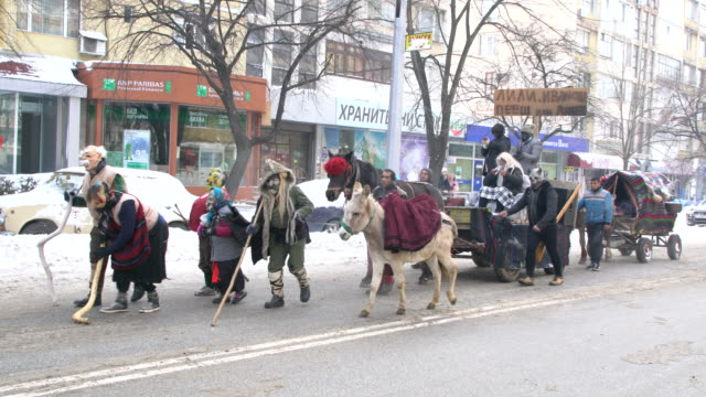 kukeri and other costumed participants marching in procession during a traditional kukeri festival - other stock videos & royalty-free footage