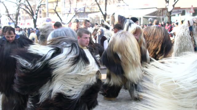 kukeri dancing during a traditional kukeri festival - traditional dancing stock videos and b-roll footage