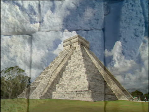kukulkan pyramid against cloudy blue sky pan right past intricate mayan carvings chichen itza\n - intricacy stock videos & royalty-free footage