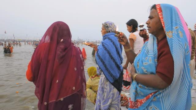 kumbh mela hindu festival 2013, naga baba gurus and pilgrims bathing in ganges river. - naga river stock videos and b-roll footage