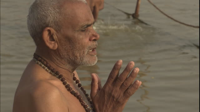 Kumbh Mela pilgrim prays in Ganges, India