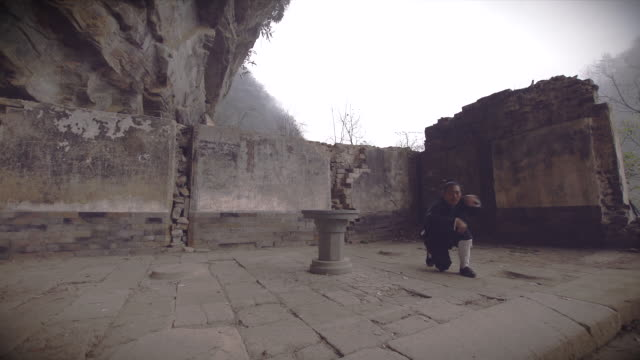 kung fu master wu training in ancient ruins in the wudang shan holy mountains. - ancient stock videos & royalty-free footage
