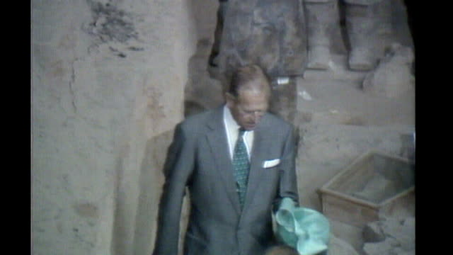 kunming int prince philip looking at terracotta warrior statues queen and prince philip seated at banquet prince drinking a toast prince philip... - prince philip stock videos & royalty-free footage