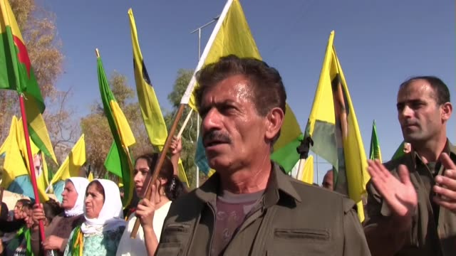 Kurdish civilians and PKK fighters chanting slogans in support of Kurdish People's Protection Unit YPG fight against ISIS in Syria during a rally in...