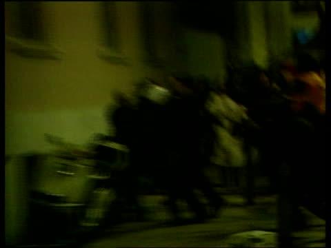 vídeos de stock, filmes e b-roll de kurdish demonstrators holding huge banner with ocalan's face on demonstrators and police clash england: london: tlms kurdish protestor running along... - autoimolação