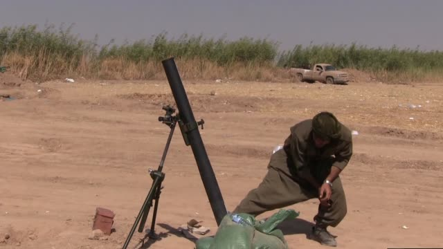 kurdish fighter of the people's defense forces hpg the military wing of the kurdistan workers' party pkk launches 81mm mortar shell into isis or isil... - kurdistan workers party stock videos & royalty-free footage